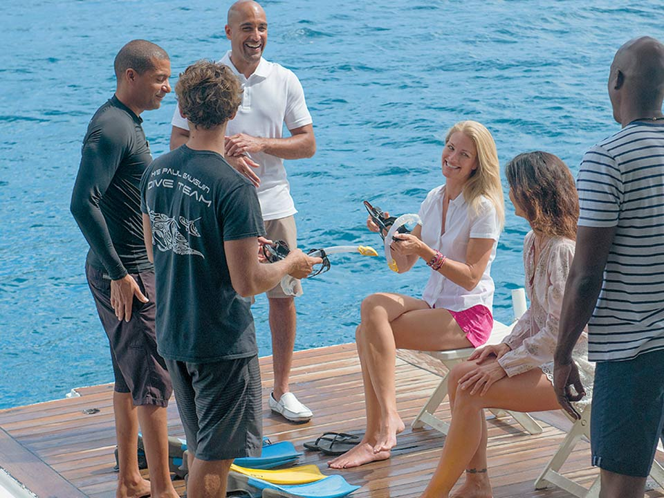 Watersports marina for complimentary kayaking and paddleboarding, and Zodiacs® for optional dive excursions