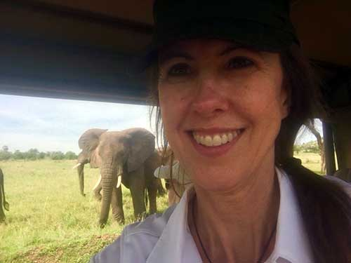 Margi and her new elephant friends on her Tanzania Safari