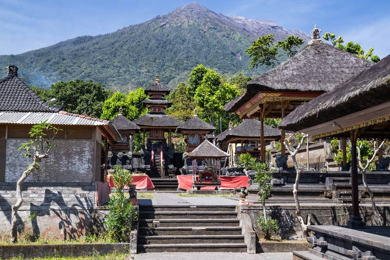 Pura Besakih temple with the summit of Mount Agung in the background.